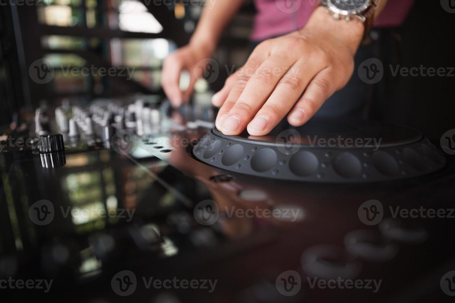 Close up of hands spinning the decks photo
