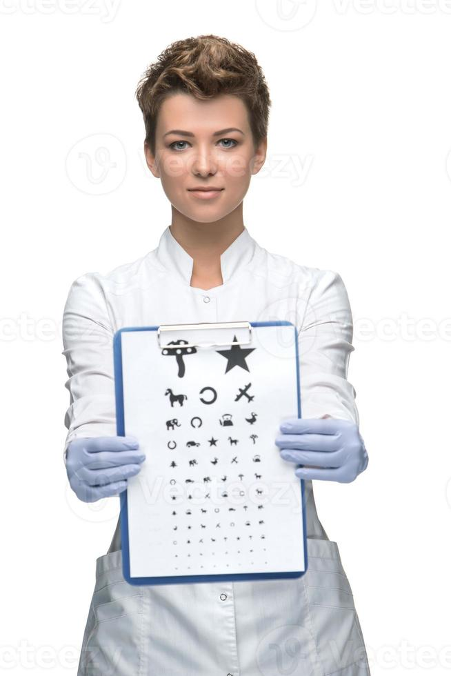 male ophthalmologist with eye chart photo