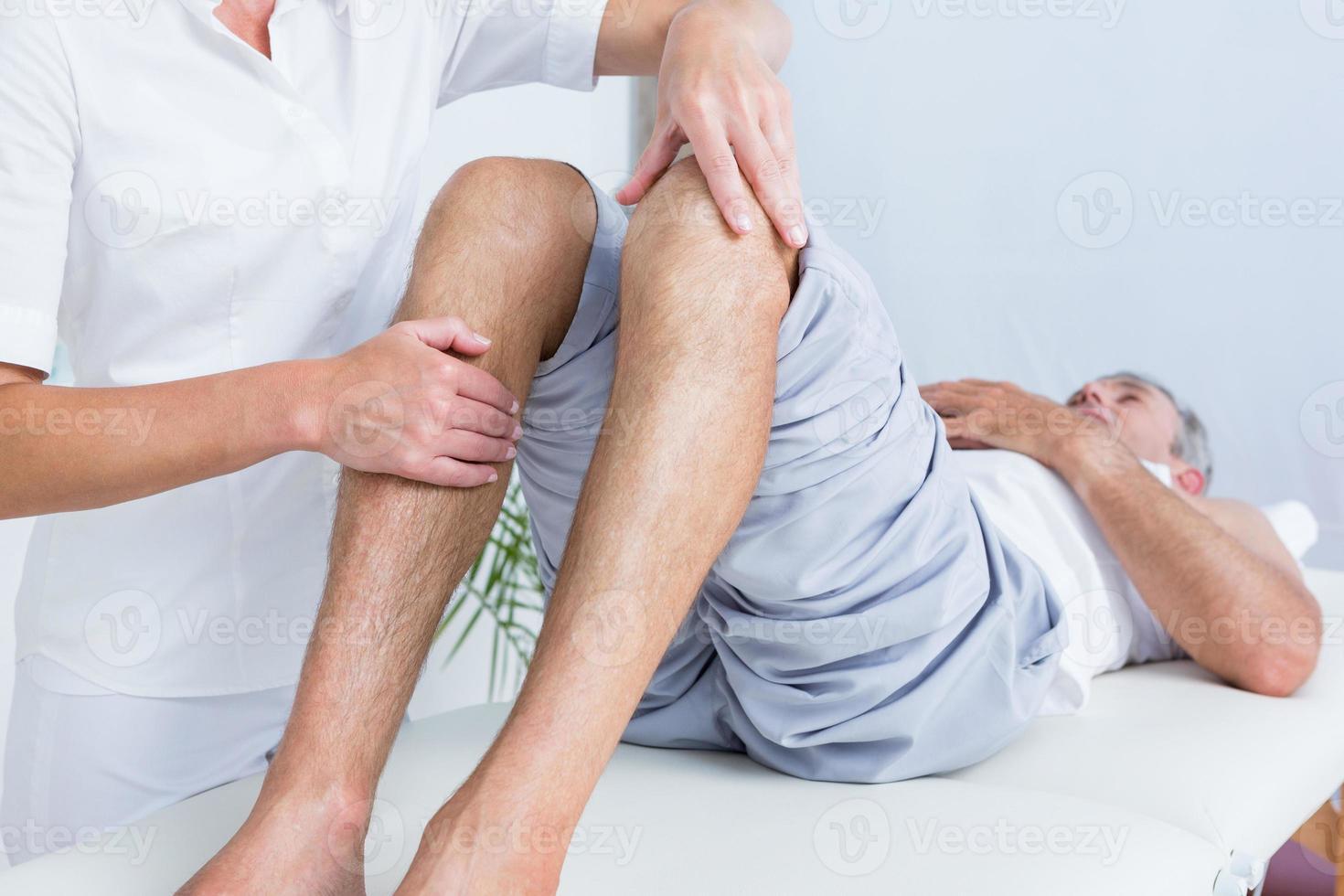 Man having knee massage photo
