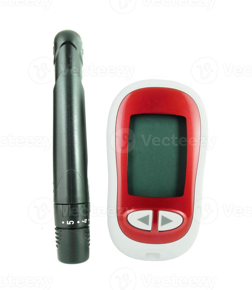 glucómetro para controlar los niveles de azúcar en la sangre foto