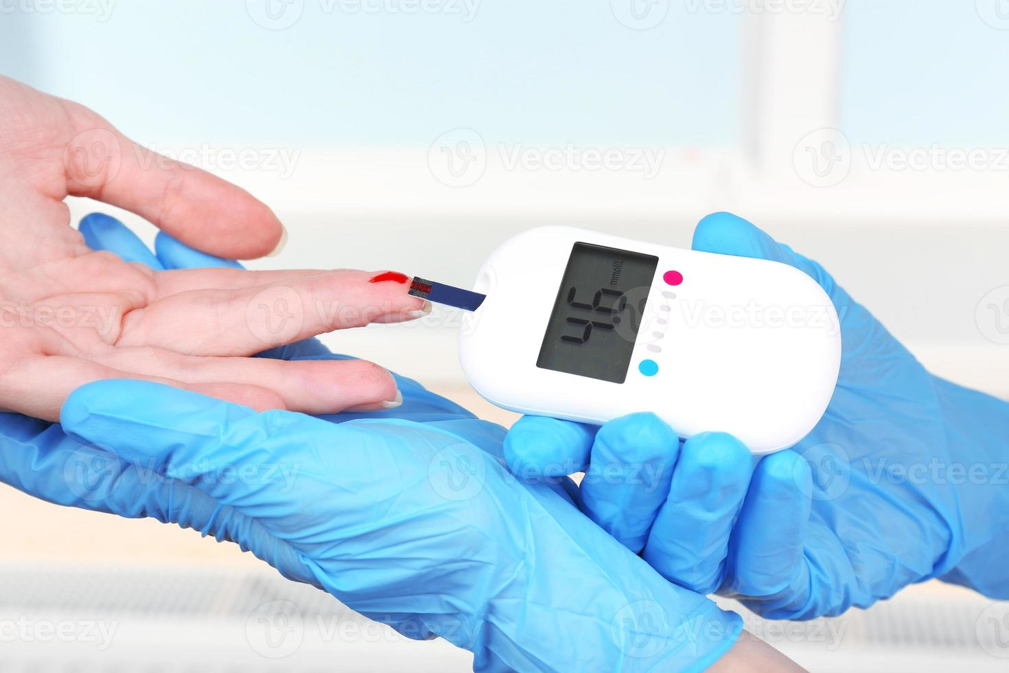Measuring glucose level blood in hospital close-up photo