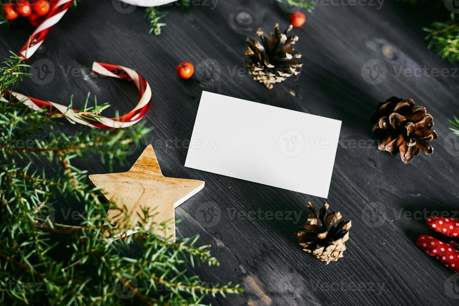 Blank business card on a Christmas wooden background photo