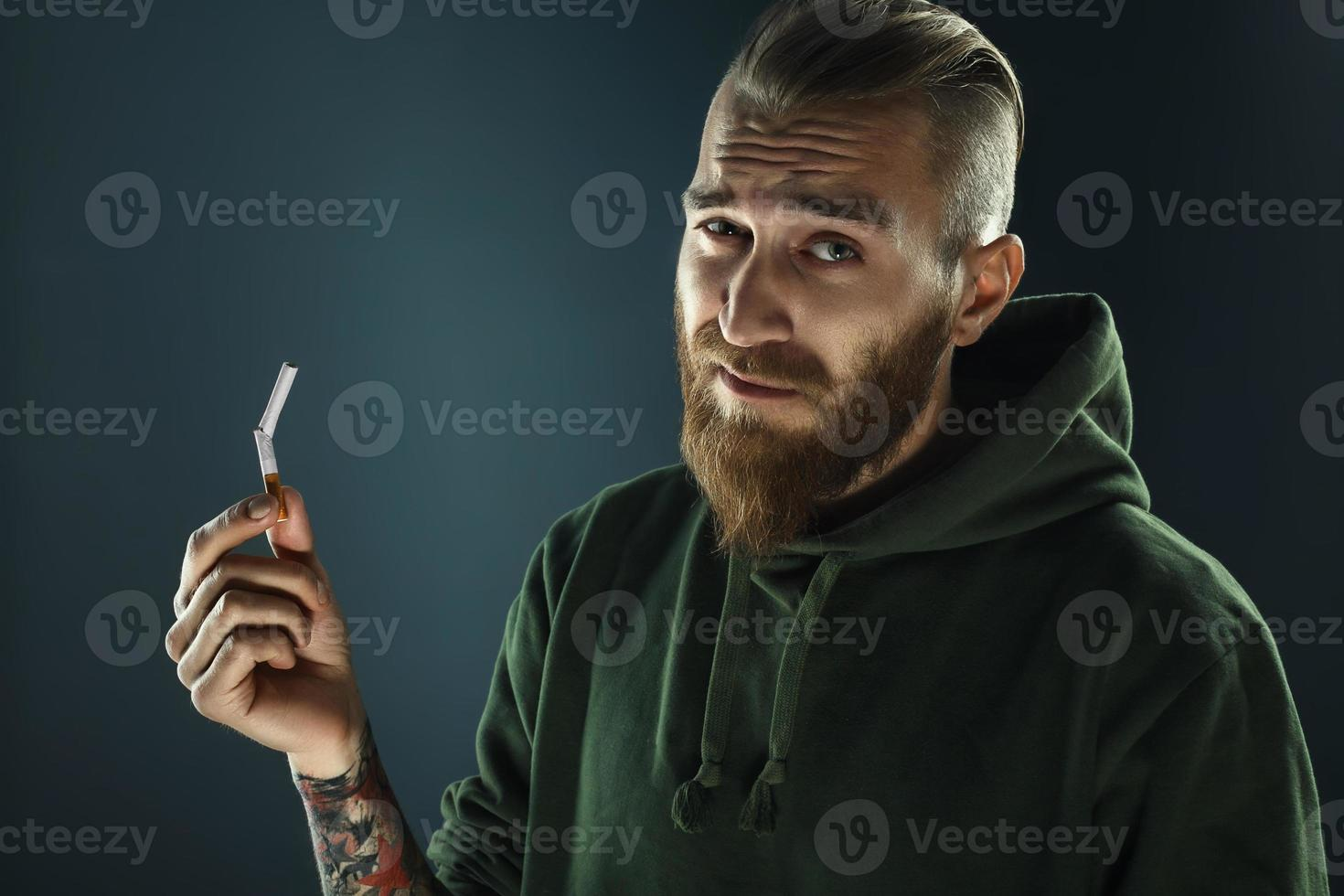 portrait of a young guy to quit smoking photo