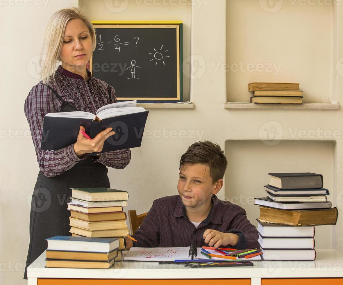 School student doing homework with the help of a tutor. photo