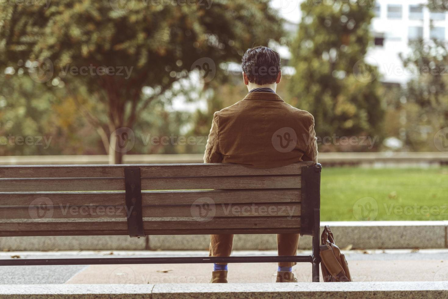 Man Relaxing On A Park Bench photo