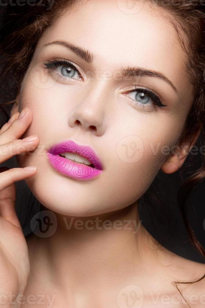 Close-up portrait of beautiful woman with bright make-up photo