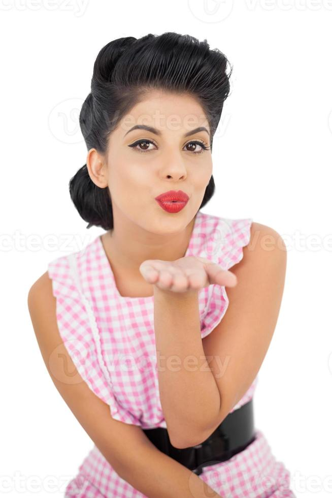 Pretty black hair model blowing a kiss to the camera photo
