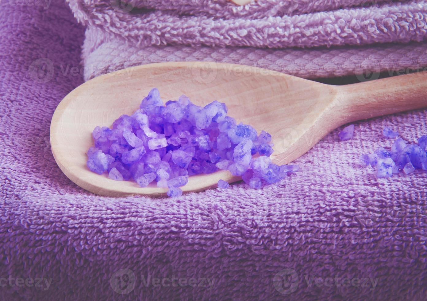 Lavender scented purpe bath salt in a wooden spoon photo