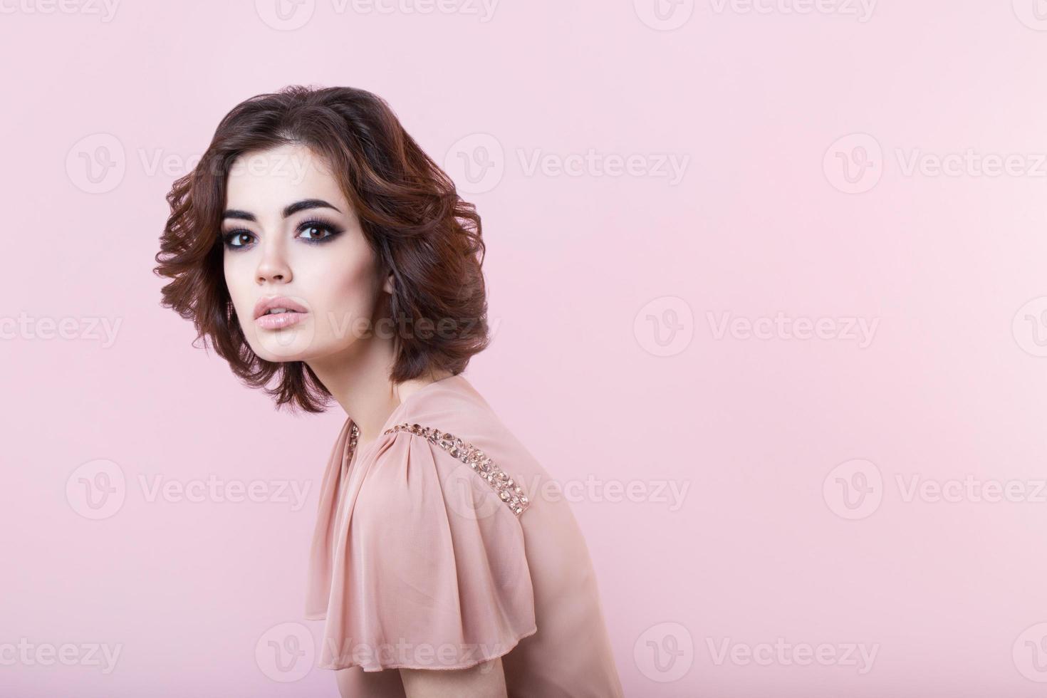 Portrait of beautiful woman in the studio photo