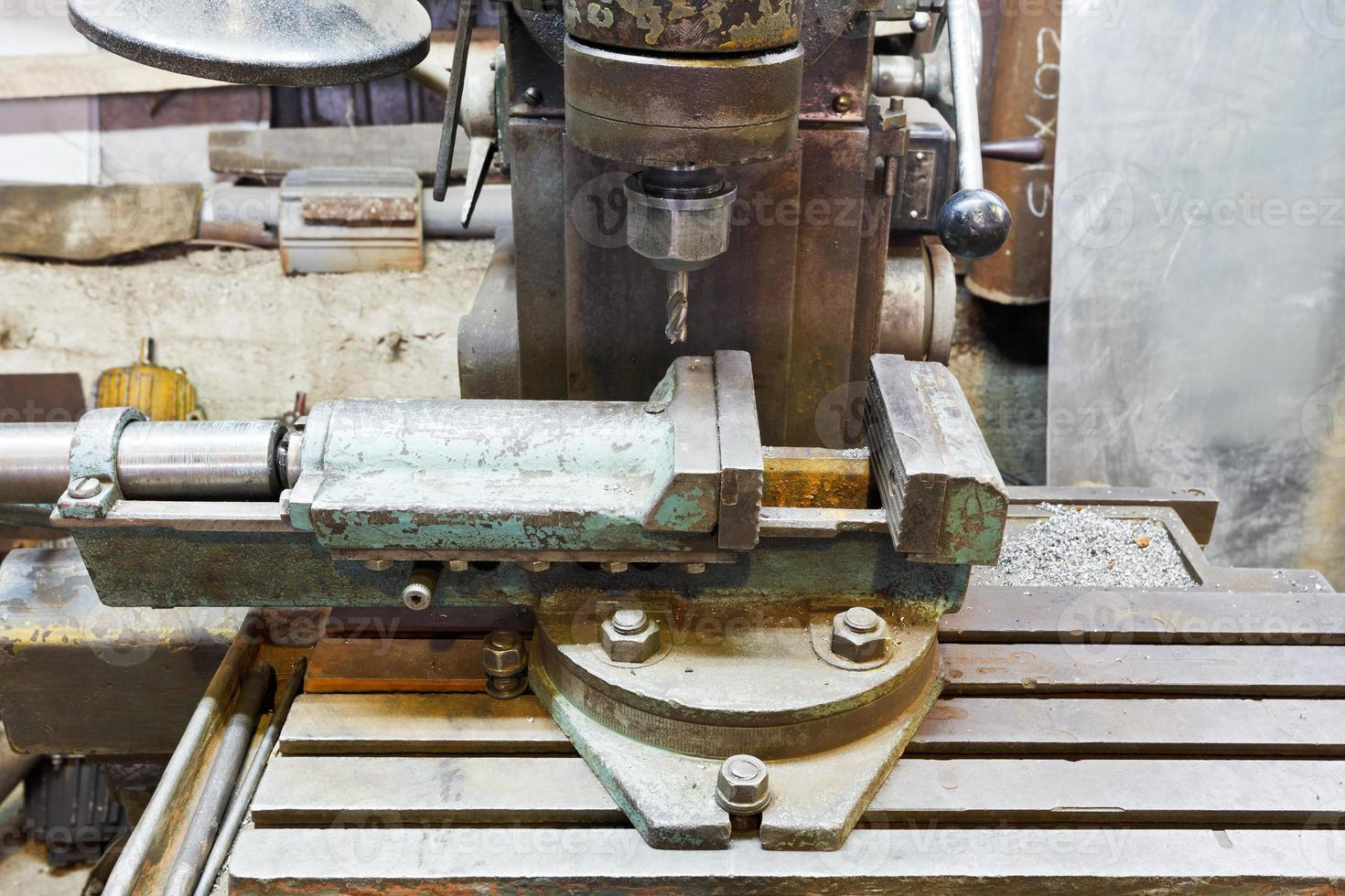 vice and drill of old boring machine close up photo