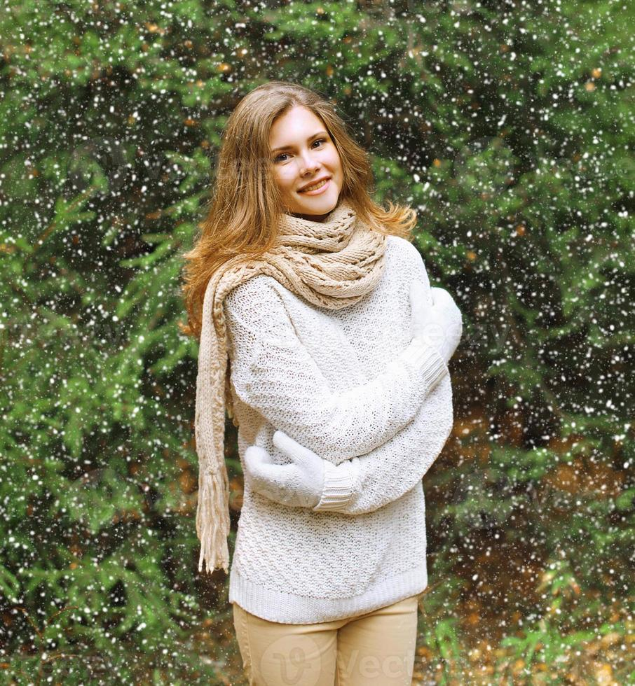 Christmas, winter and people concept - happy pretty young girl photo