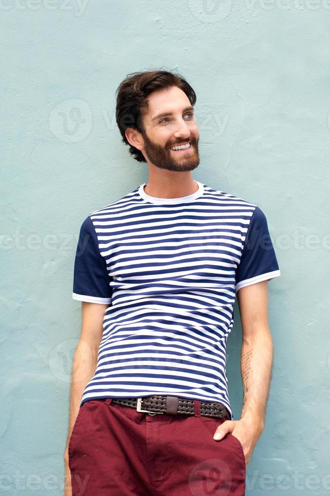 Handsome happy man with beard smiling photo
