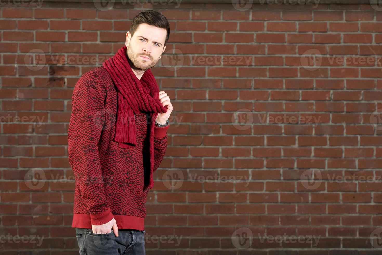 Handsome young man standing outdoors photo