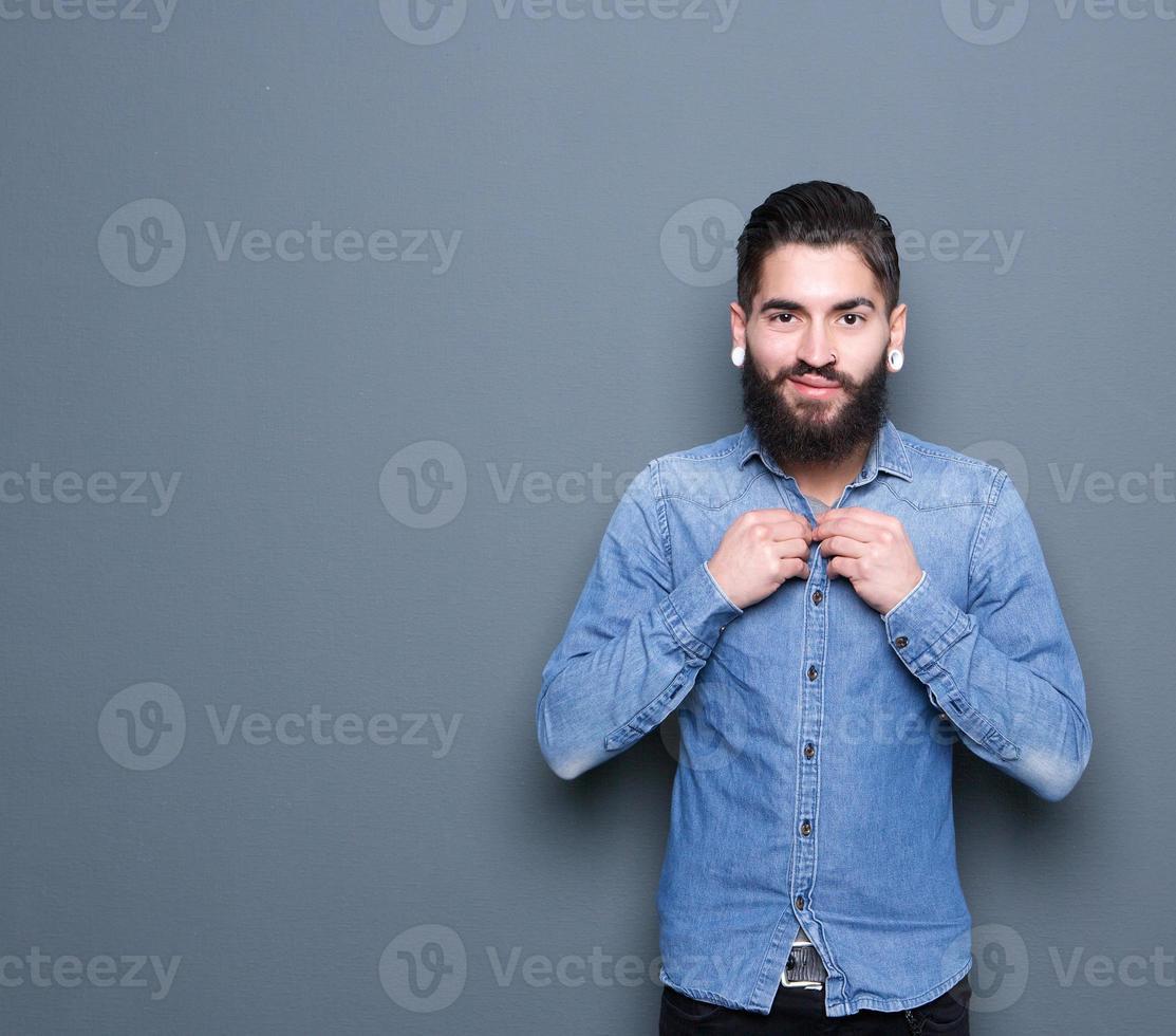Man adjusting buttons on shirt photo