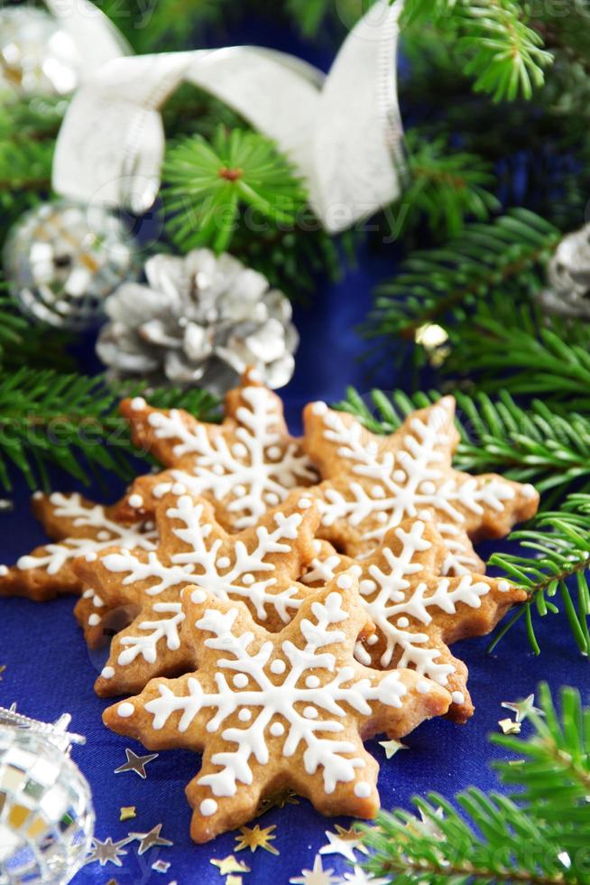 Christmas gingerbread cookie in the form of a snowflake. photo