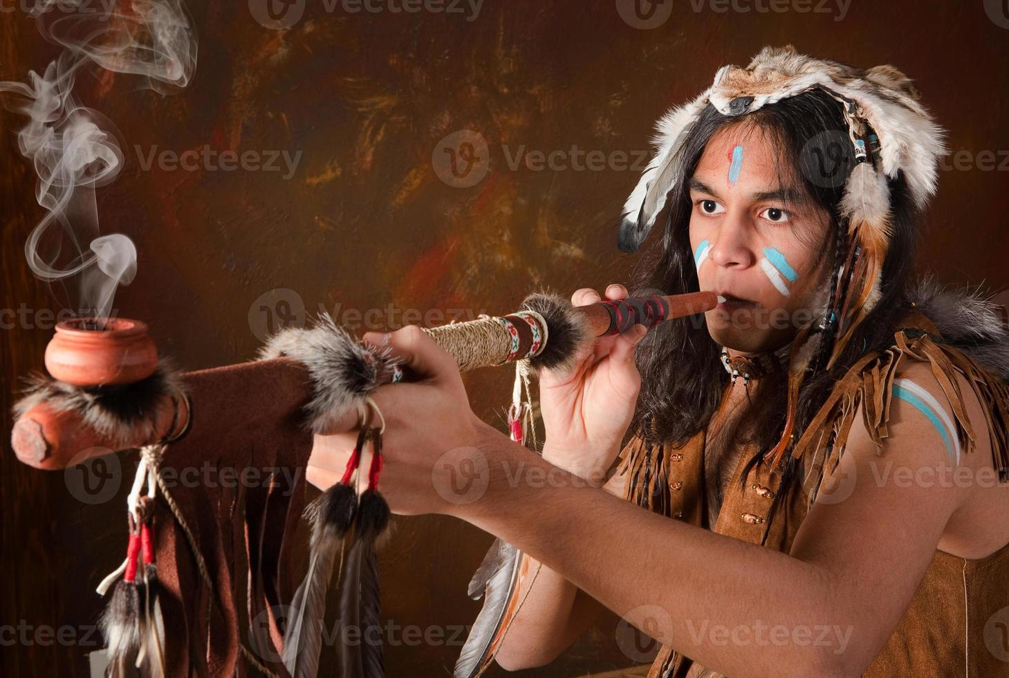 Indian with peace pipe photo