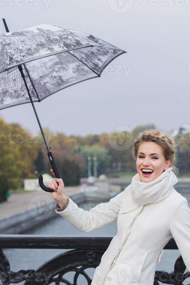 Happy girl with umbrella photo