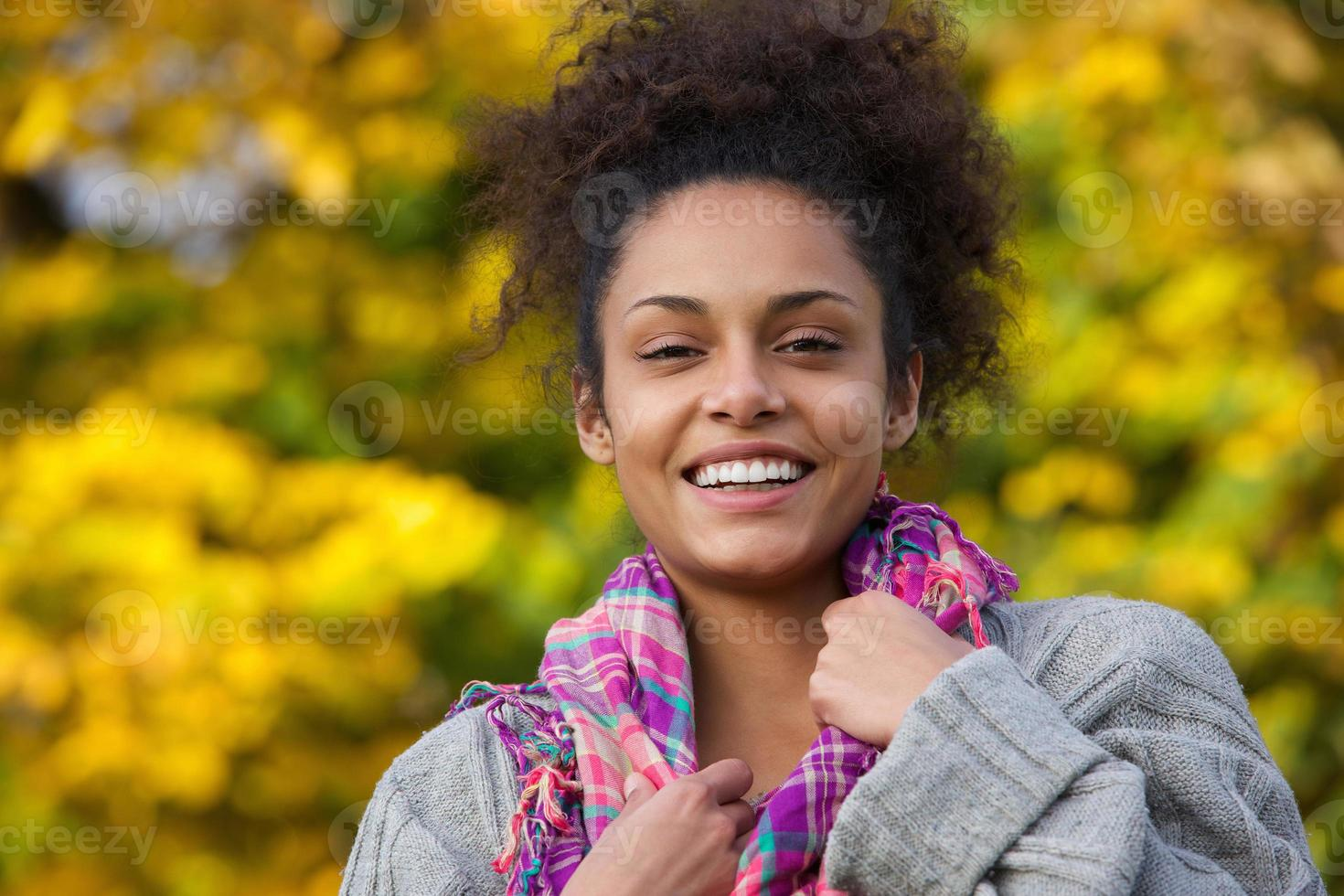 Attractive young african american woman smiling in autumn photo