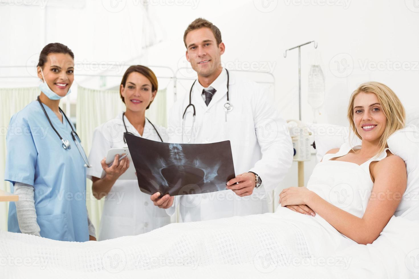 Portrait of doctors and patient with x-ray photo