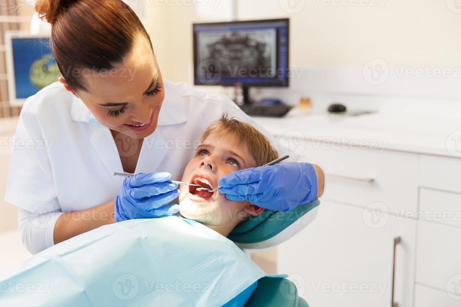 boy visits the dentist for a check up photo