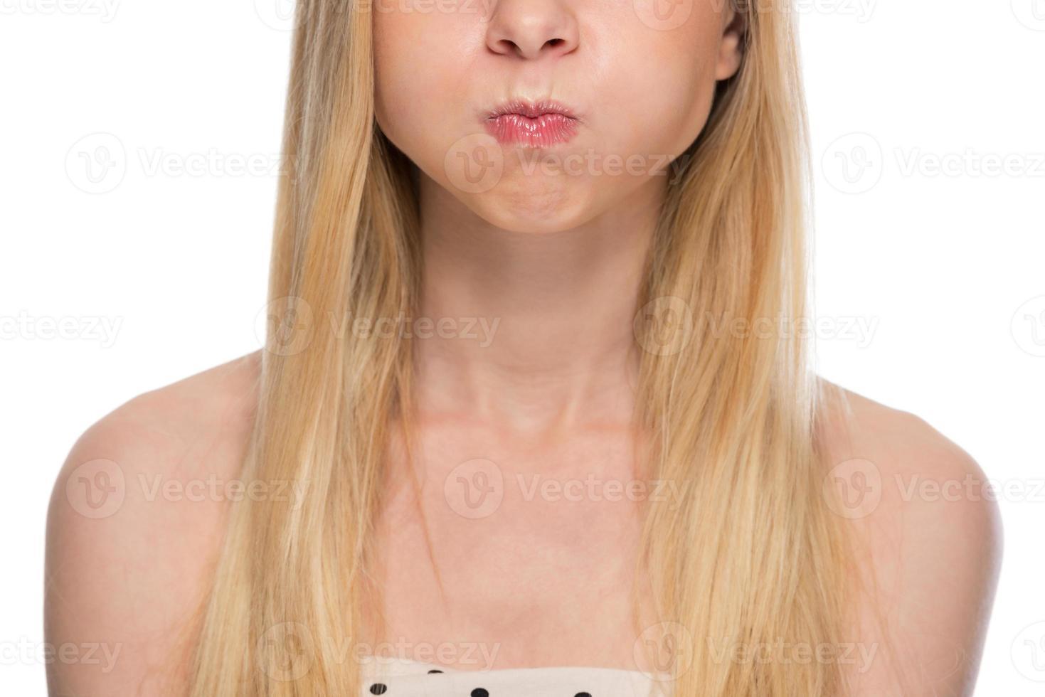 closeup on teenager holding breath photo