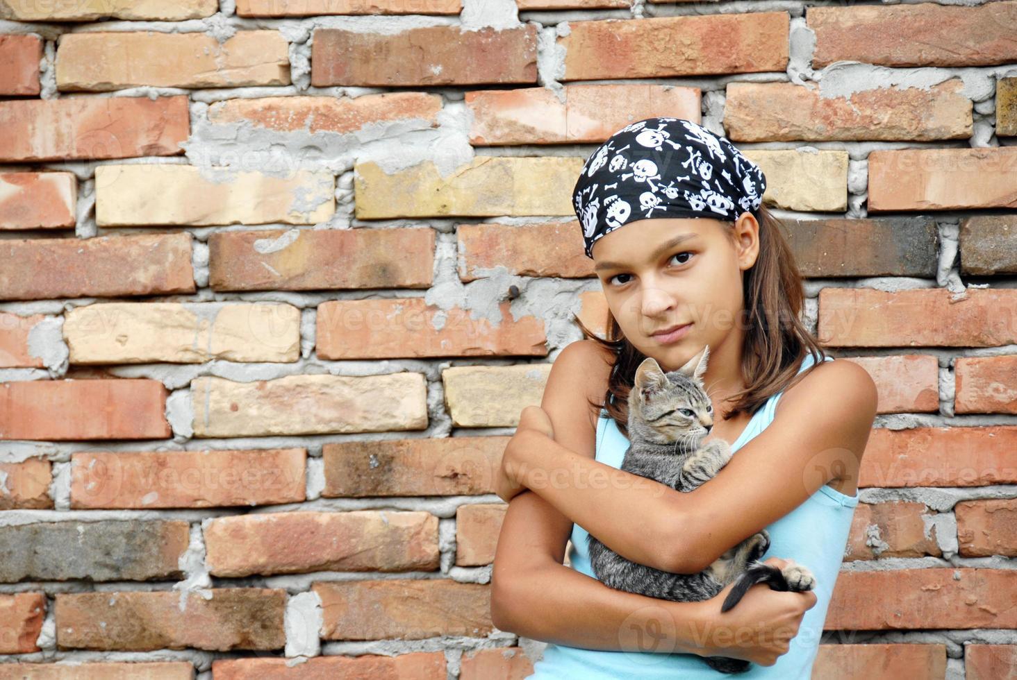 Retrato de adolescente con gato foto