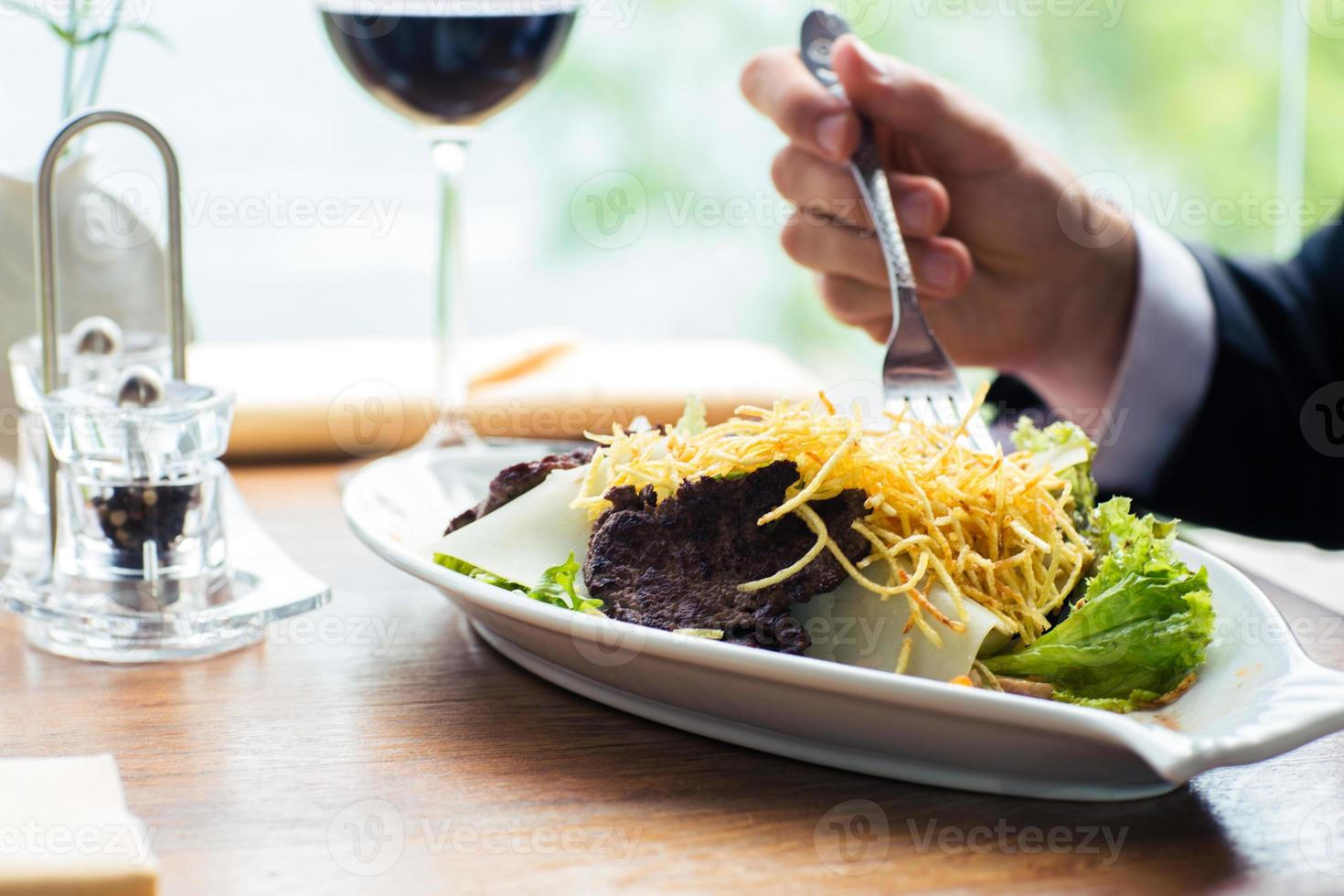 Male hands eating salad photo