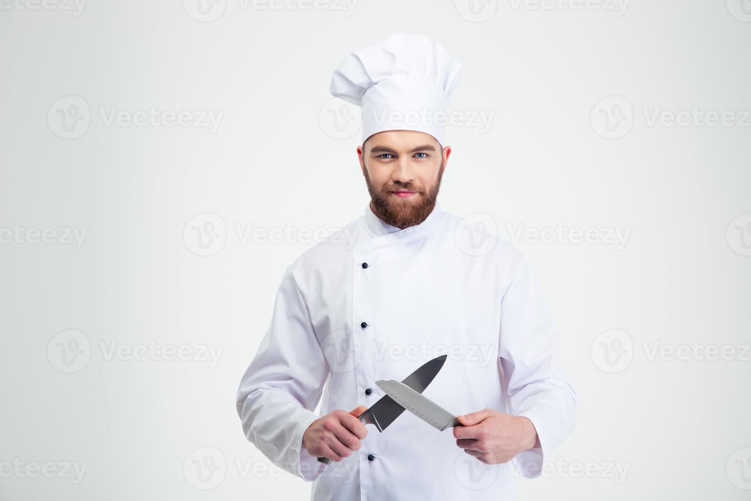 Happy male chef cook sharpening knife photo