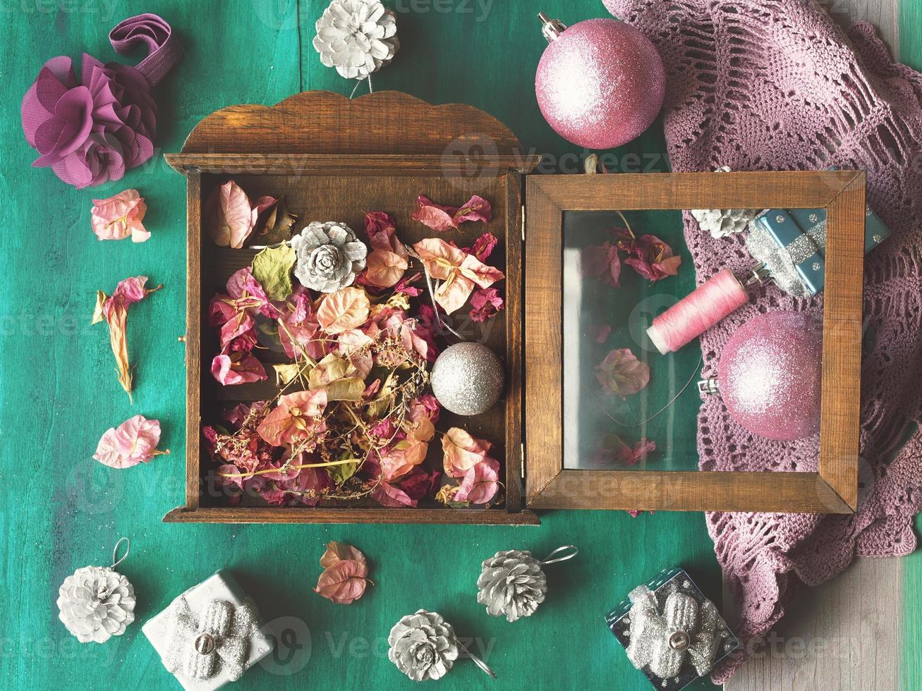 Christmas still life with flowers and decorations on green photo
