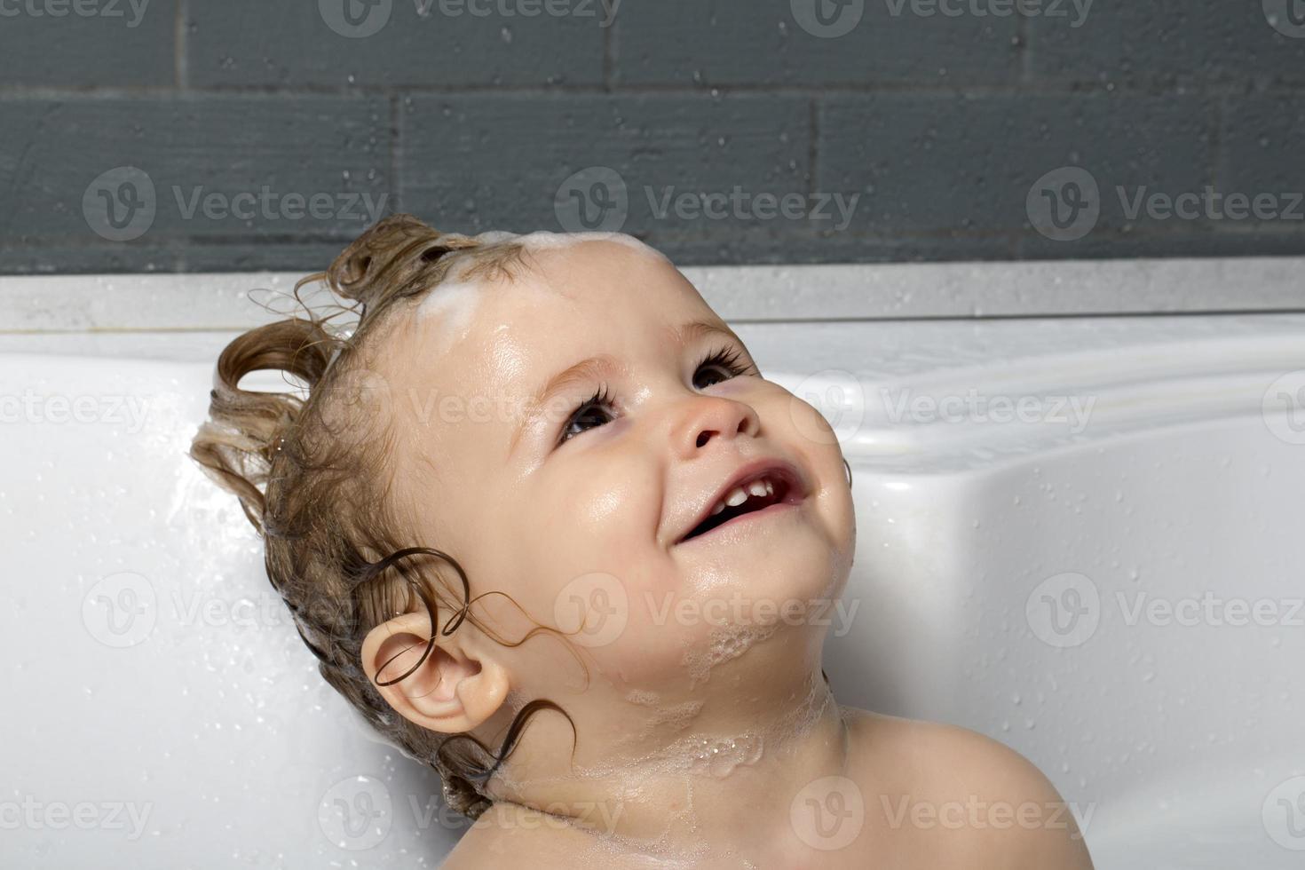 Happy baby boy in bath photo