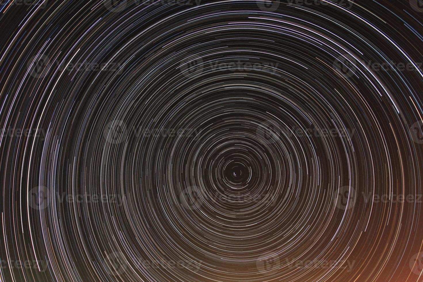 star trails at night sky photo