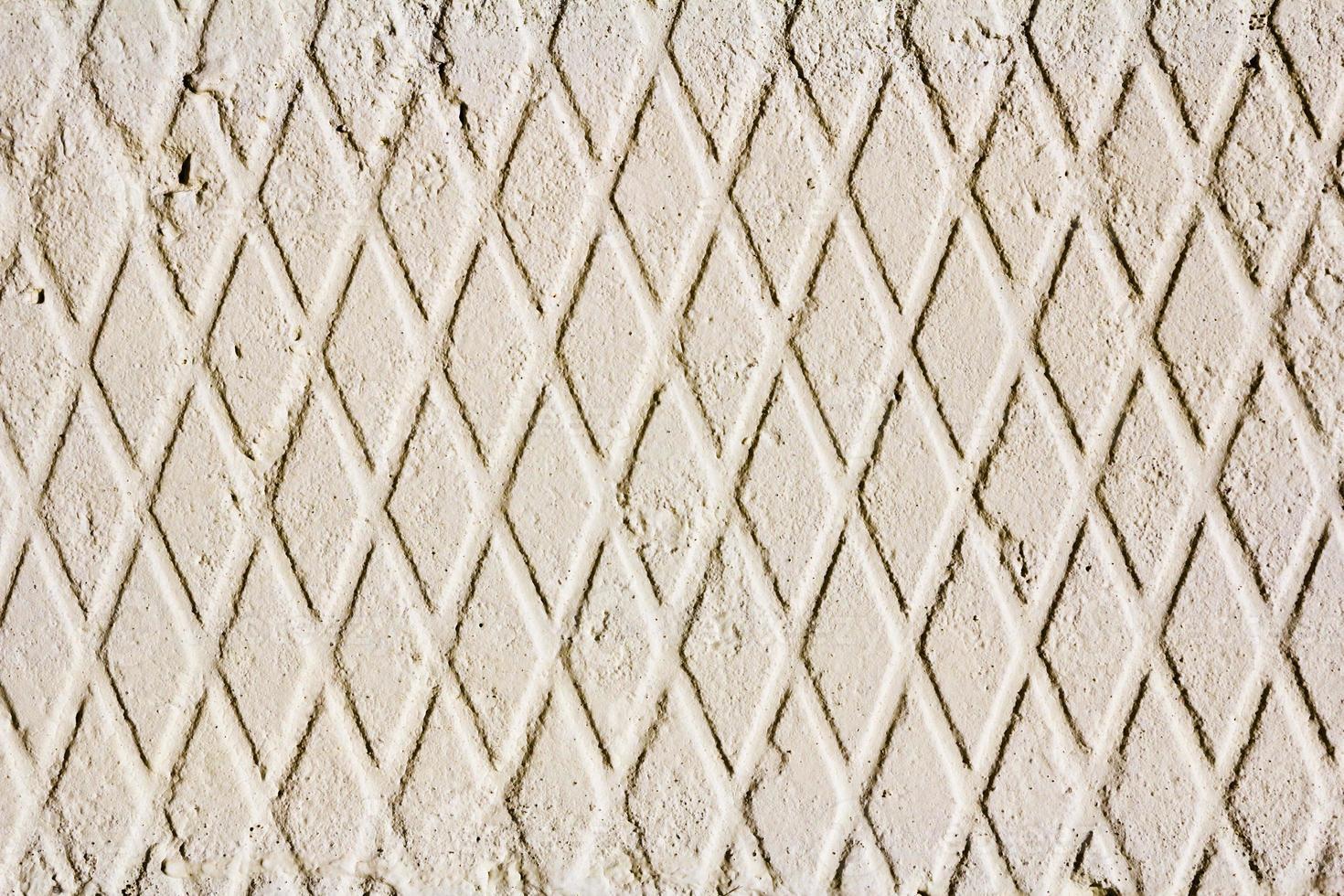 muro de hormigón con motivos geométricos foto