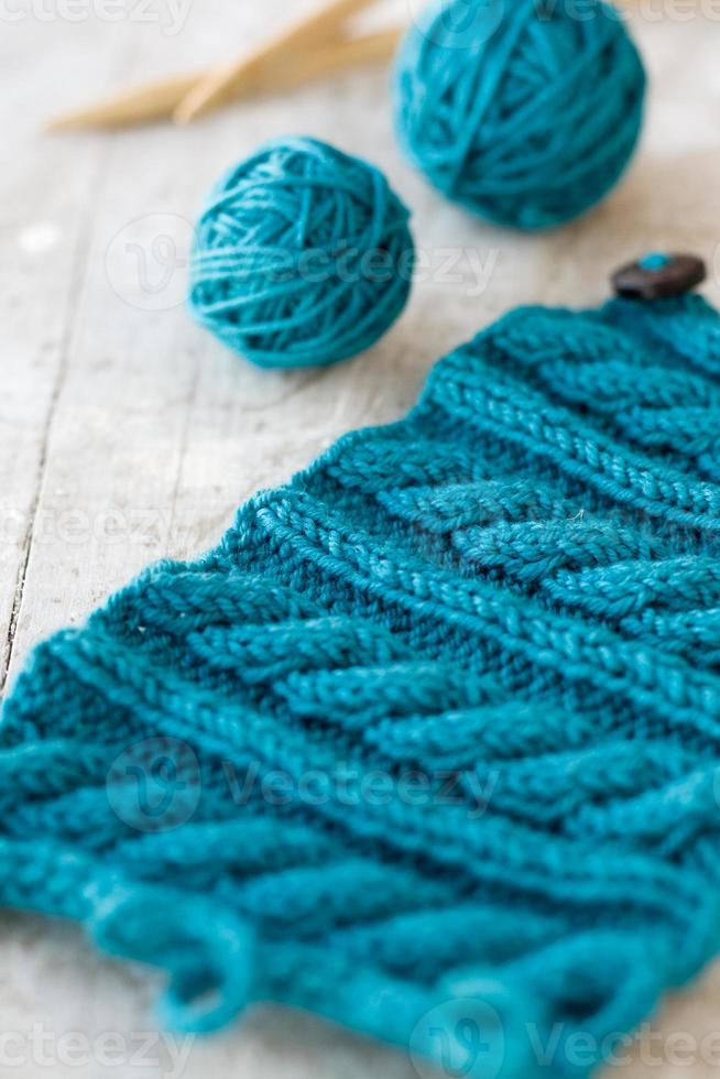Knitting pattern and needles on a wooden background photo