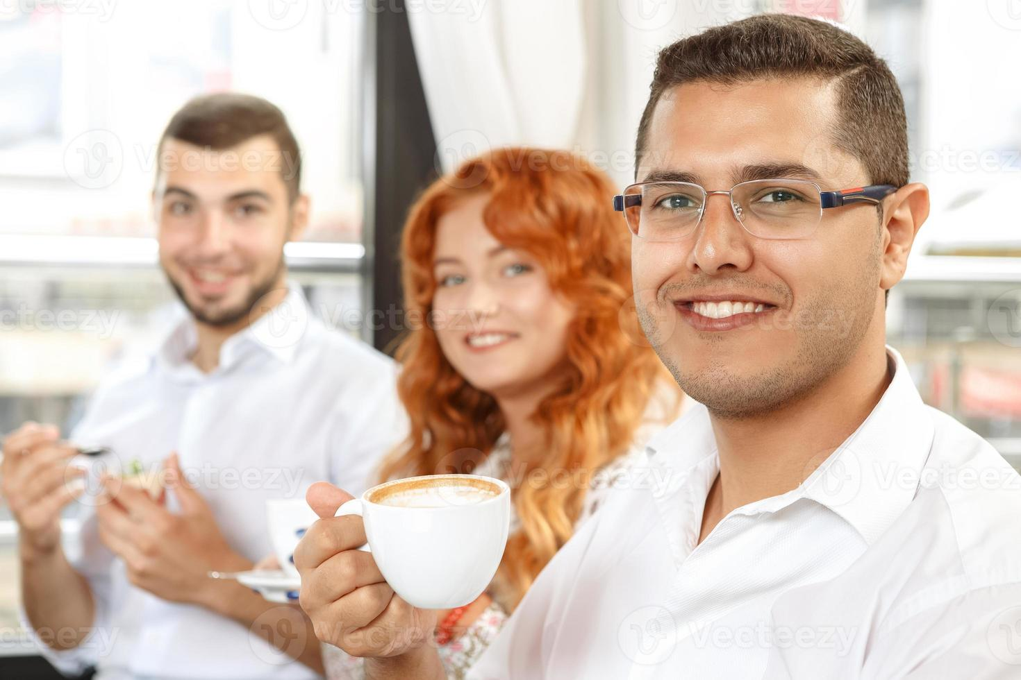 Coffee break of busines colleagues photo