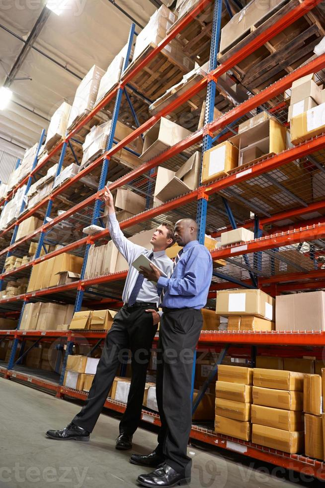 Two Businessmen With Digital Tablet In Warehouse photo