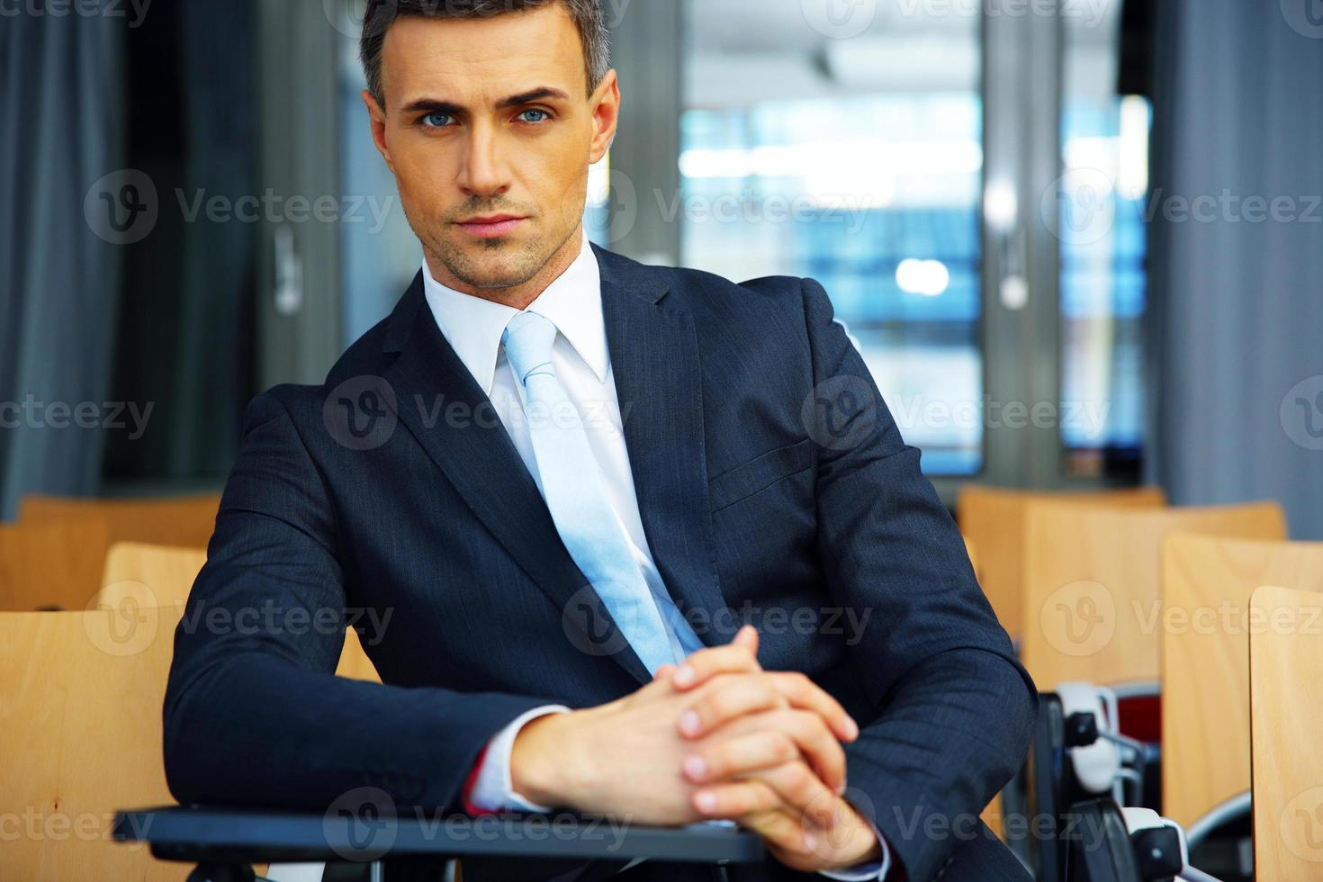 businessman standing at conference hall photo
