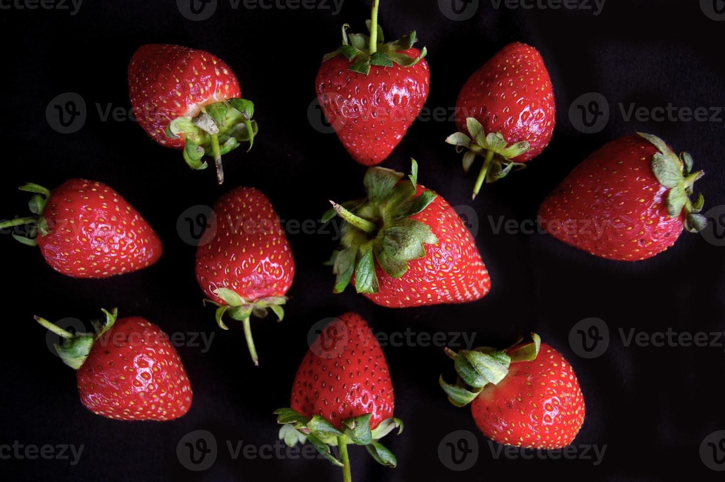 Strawberry fruit pattern on black background photo