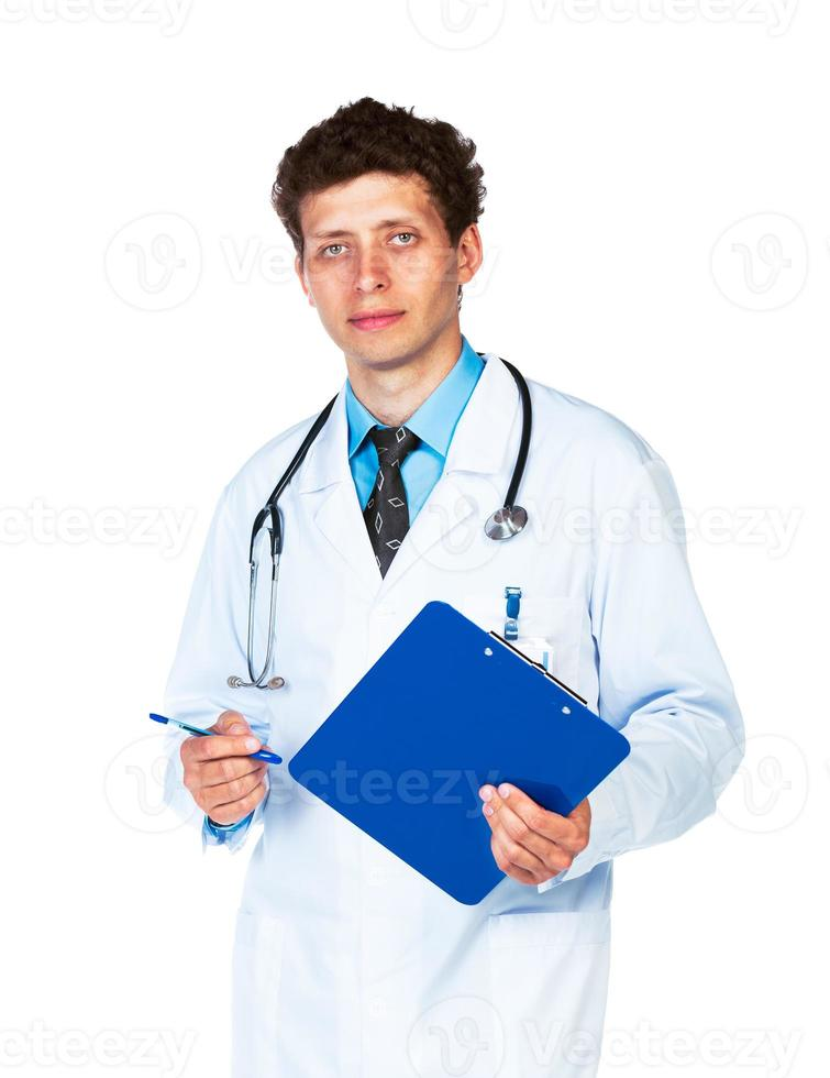 young male doctor writing on a patient's medical chart photo