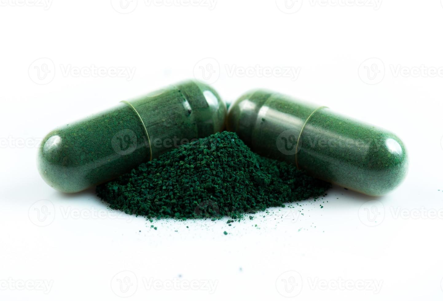 green herbal medicine capsule isolated on white background photo