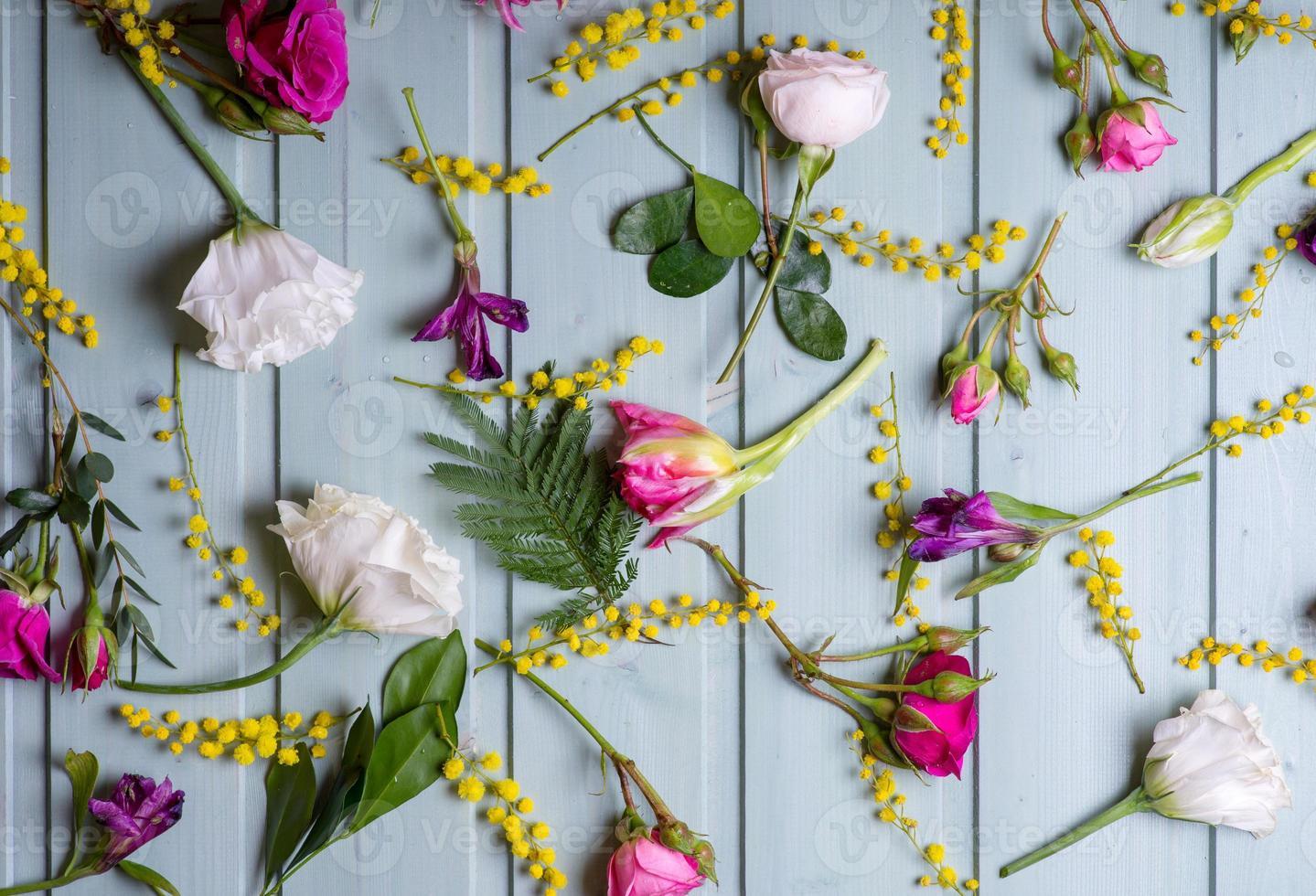 Pattern of Flowers on vintage wood background photo