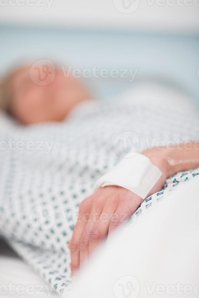 centrarse en la mano de una paciente foto