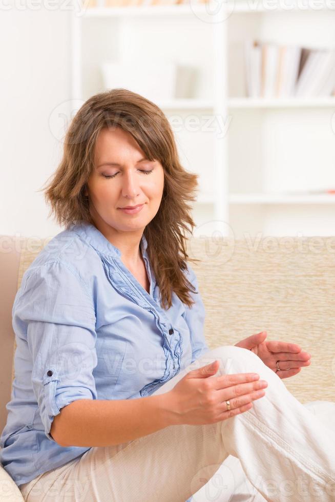 Woman practicing energy medicine photo