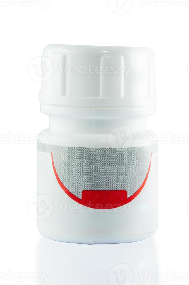 botella de medicina en blanco foto