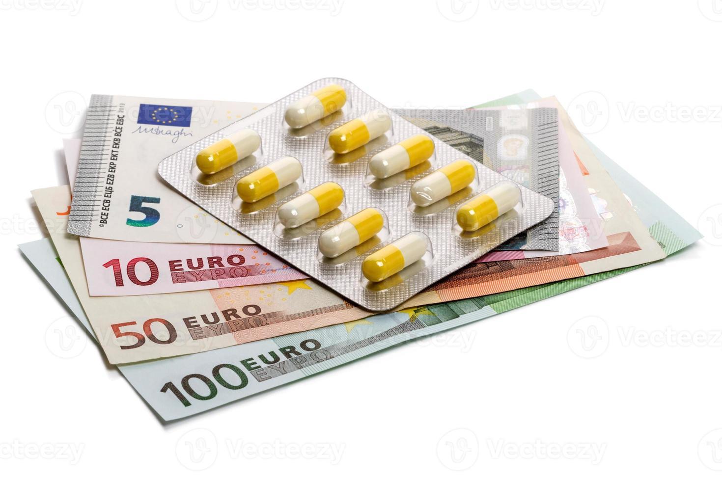 Medicines and euro banknotes photo