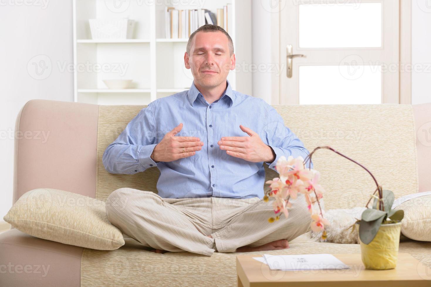Man practicing energy medicine photo