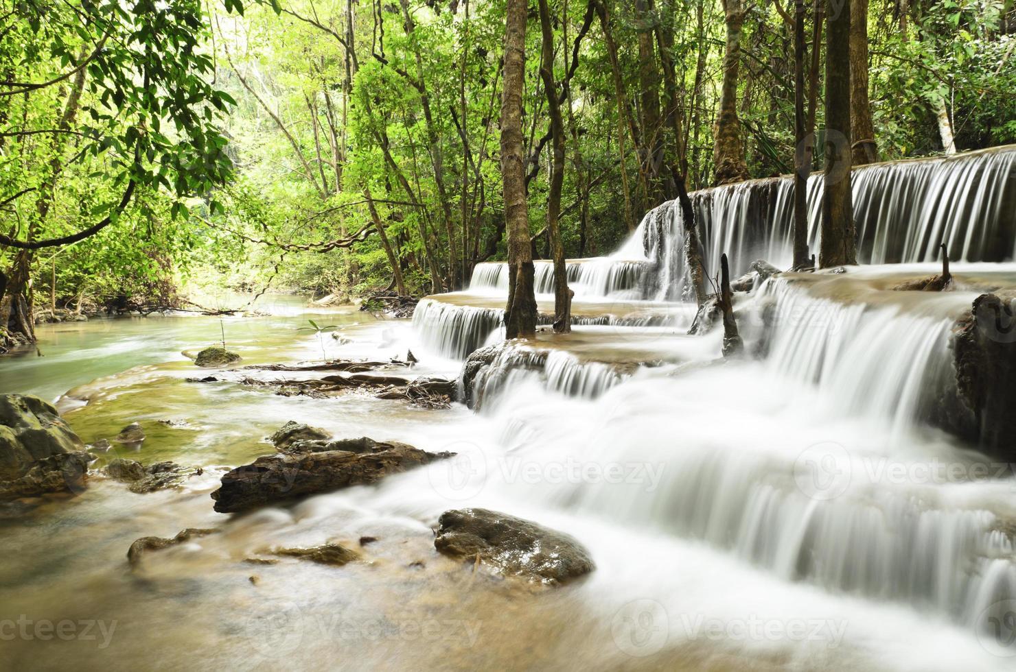 Waterfall in deep jungle photo