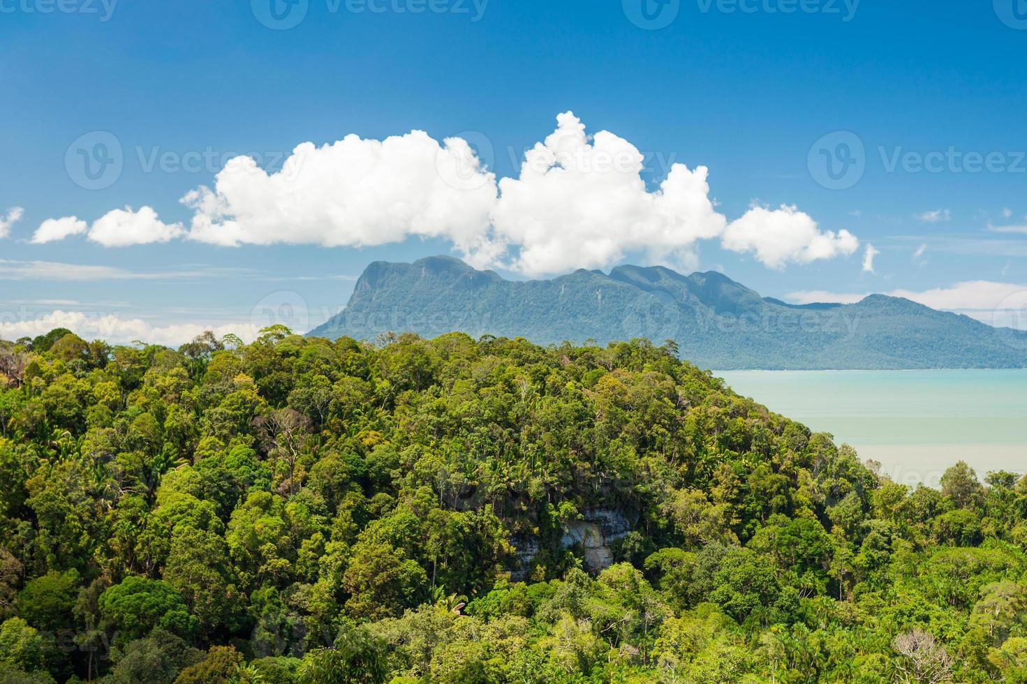 Tropical landscape over jungle and hills photo