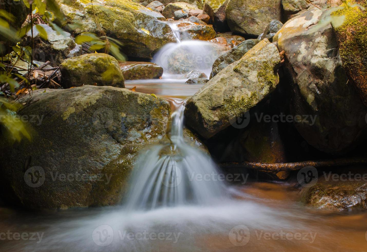 Waterfall in deep rain forest jungle at National Park, photo