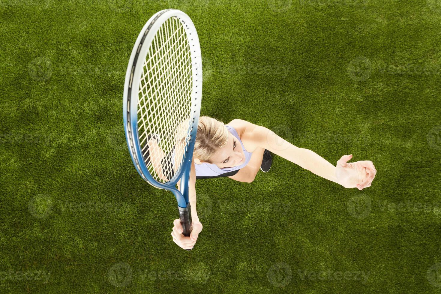 Tennis player on playground photo