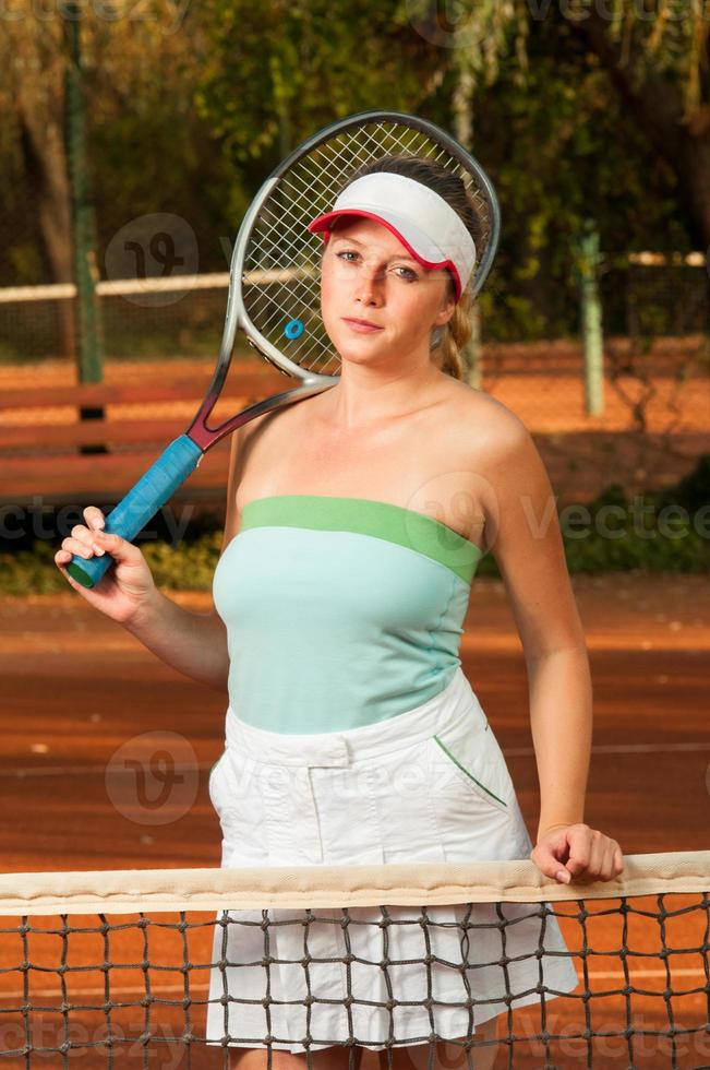 Portrait of young woman tennis player photo